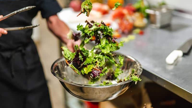 Chef tossing salad