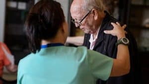 Nurse assisting senior man