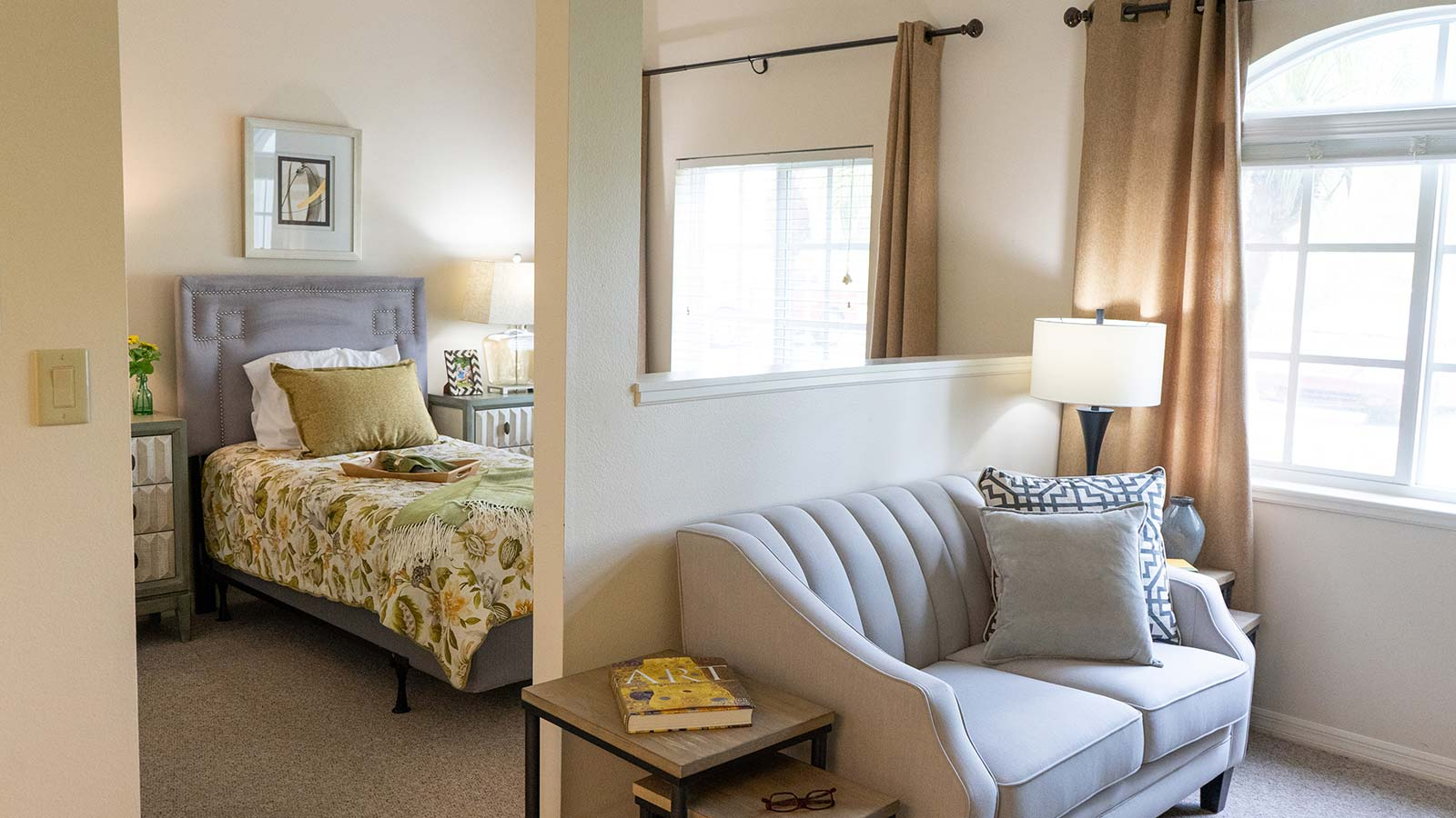 Model apartment bedroom and living room at Heron Club assisted living and memory care in Sarasota Florida