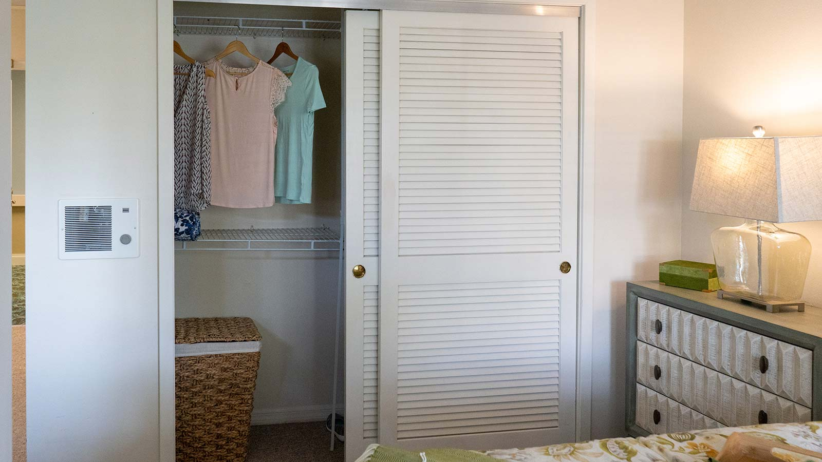 Model apartment bedroom closet at Heron Club assisted living and memory care in Sarasota Florida