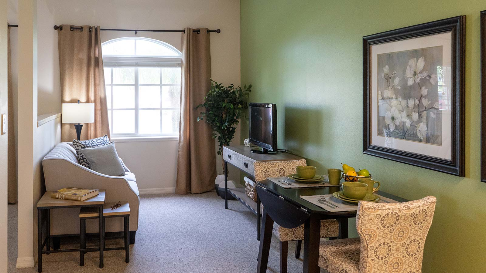 Model apartment living room at Heron Club assisted living and memory care in Sarasota Florida