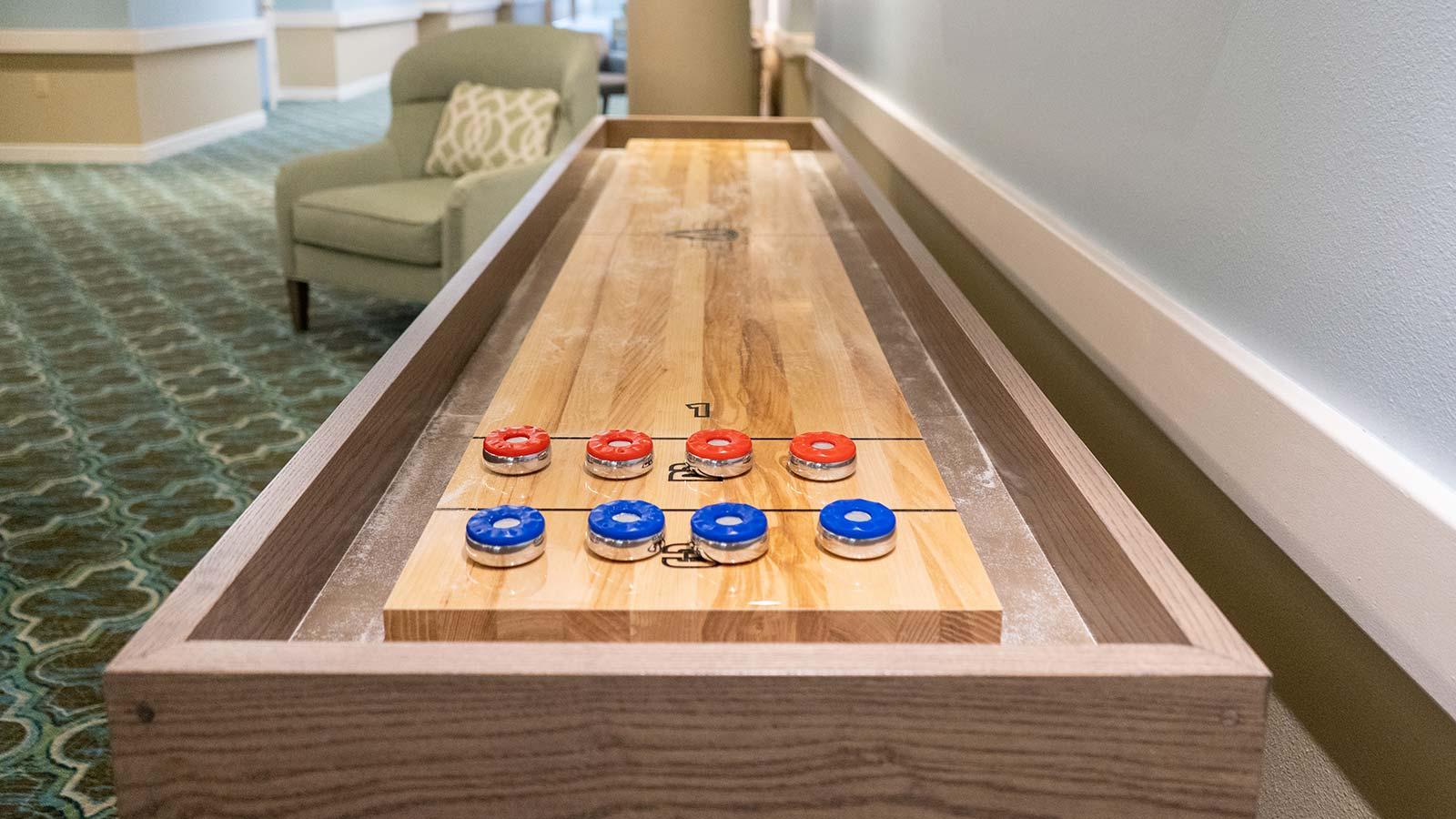Shuffleboard table at Heron Club assisted living and memory care in Sarasota Florida
