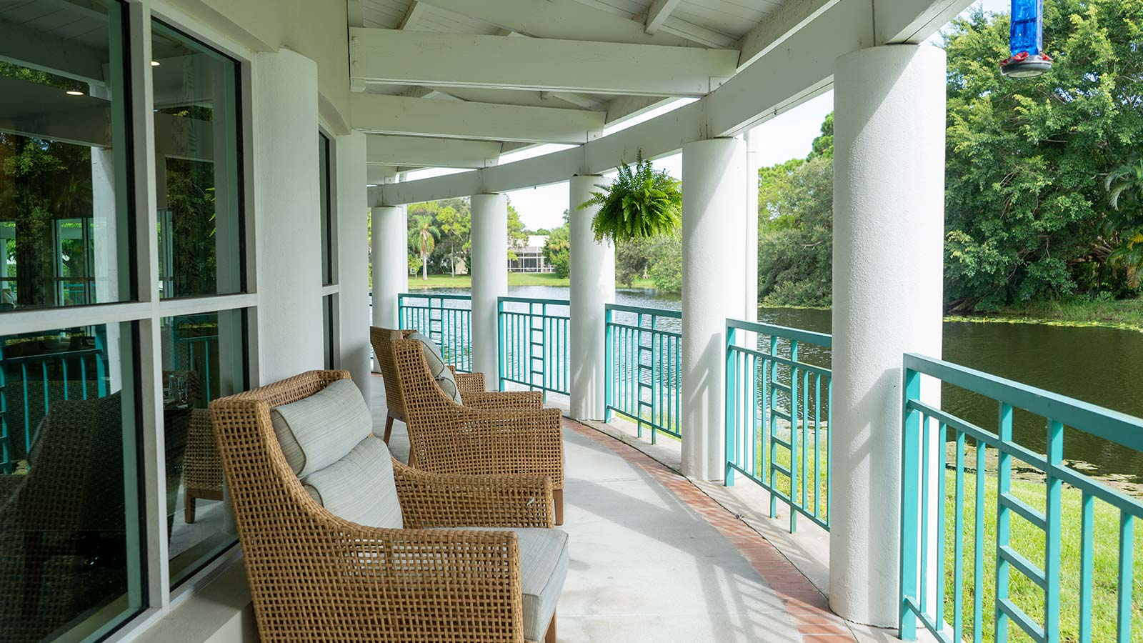 Outdoor lakefront porch at Heron Club assisted living and memory care in Sarasota Florida