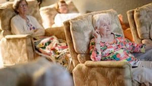 Senior women watching movie in recliners